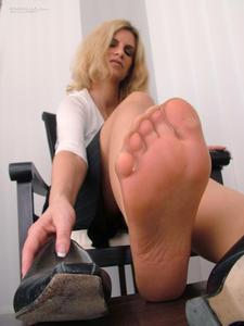Our secretarys smelly feet. Viktoria wears black high heels and skin colored ...